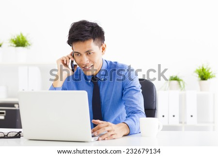 happy Young businessman working in the office - stock photo