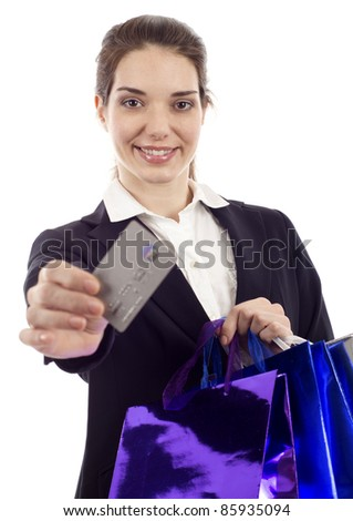 Happy young businesswoman holding credit card with shopping bags isolated over white - stock photo