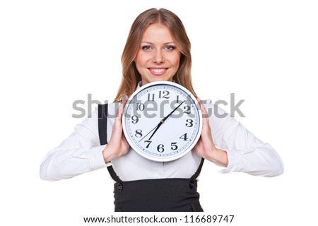 happy young businesswoman holding the clock and smiling. isolated on white background