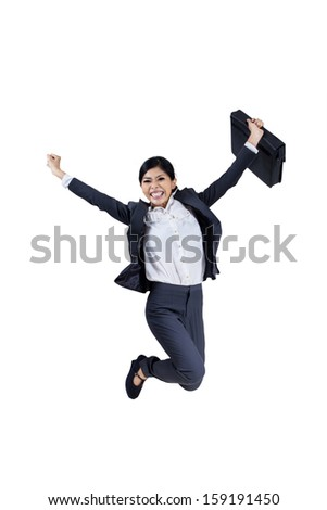 Happy young businesswoman is jumping with a briefcase on white background - stock photo