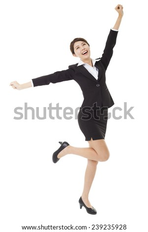 happy young businesswoman jumping and dancing - stock photo