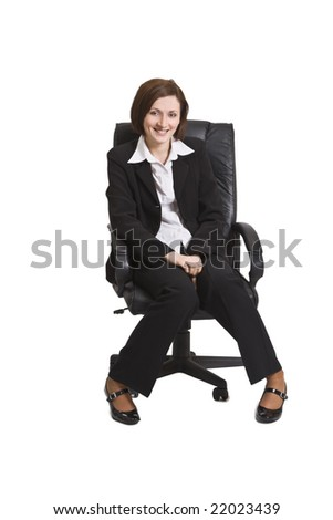 Happy young businesswoman siting on a chair isolated against a white background.