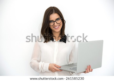 Happy young businesswoman standing with laptop, vignette - stock photo