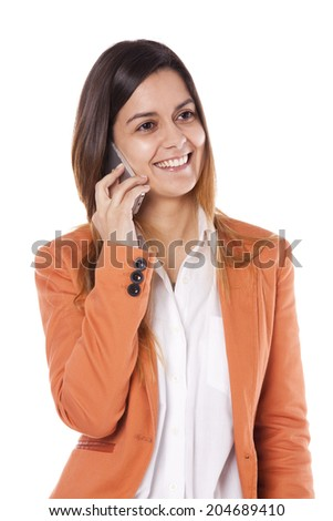 Happy young businesswoman talking on a smart-phone - stock photo