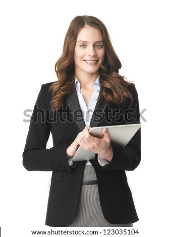 Happy young businesswoman using her digital tablet against (isolated) white background - stock photo