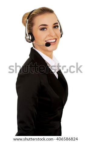 Happy young businesswoman with headset - stock photo