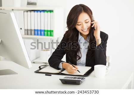 happy young businesswoman working in the office - stock photo