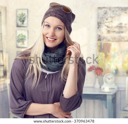 Happy young casual caucasian blonde visual artist woman at retro room. Standing, smiling, looking at camera. - stock photo