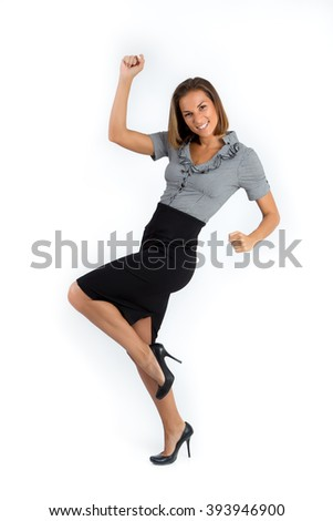 Happy young caucasian business woman in full length, punching the air full of joy, celebrating success. Isolated on white background. - stock photo
