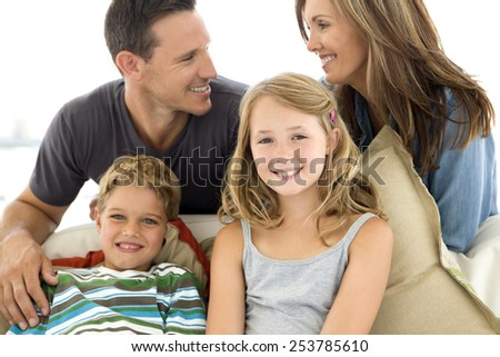 Happy young Caucasian family - stock photo