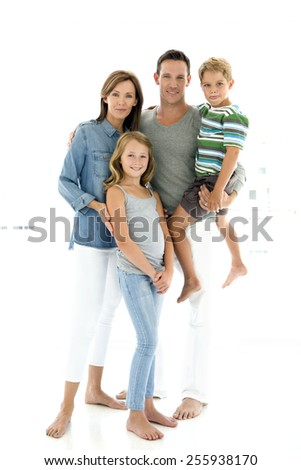 Happy young Caucasian family with two children - full length portrait - stock photo