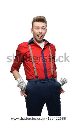 happy young caucasian man in red vintage clothing with money in his pockets isolated on white