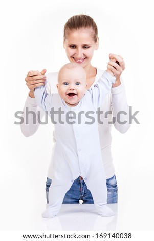 Happy young Caucasian woman and her baby son over white  - stock photo
