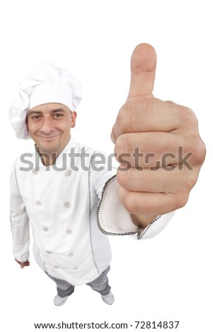 Happy young chef holding thumbs up. Distorted image taken in studio with fish eye lens. Isolated on pure white background. - stock photo