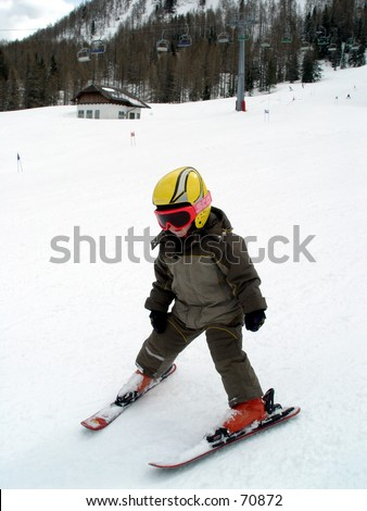 Happy young child skiing - stock photo