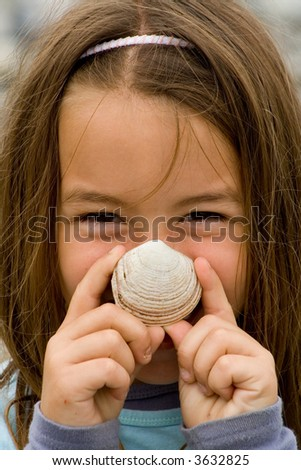 Happy Young Child with a seashell