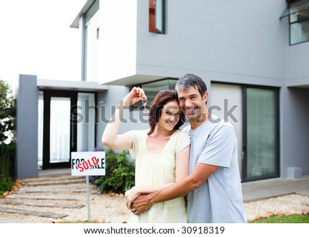 Happy young couple after buying house