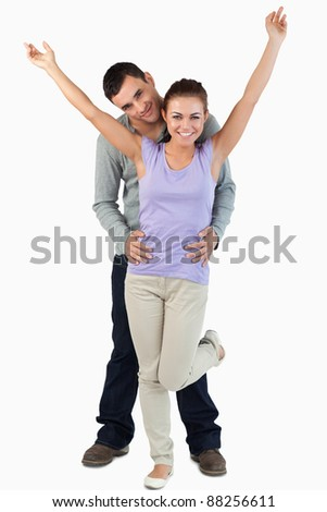 Happy young couple against a white background - stock photo