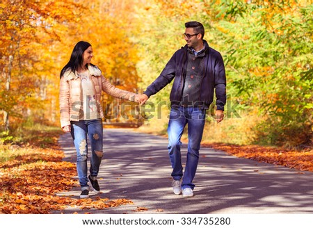 Happy young couple at first date taking a walk in nature. Vintage effect.