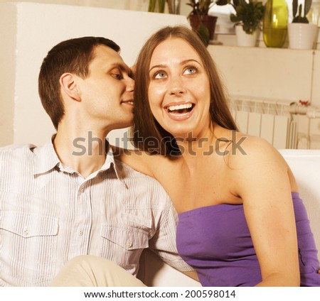 happy young couple at home smiling relaxing