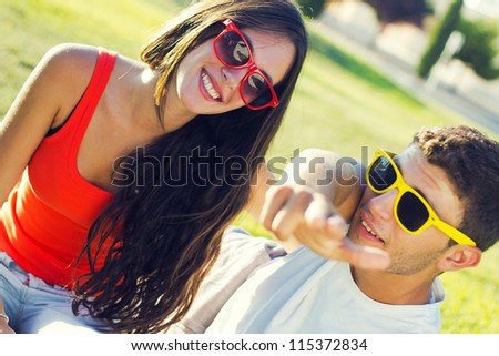 happy young couple at the park - stock photo