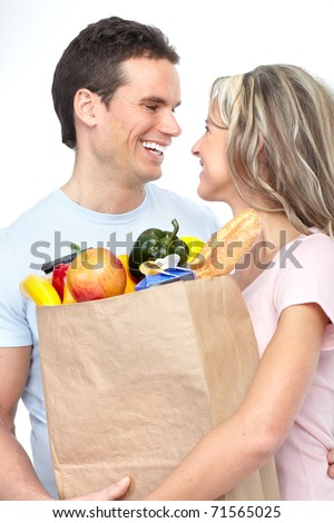Happy young couple carrying shopping bags with food