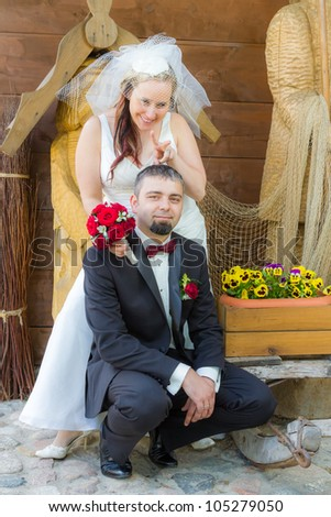 Happy young couple clowning around - stock photo
