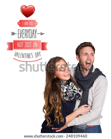 Happy young couple embracing against valentines day greeting - stock photo
