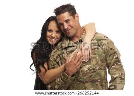 Happy young couple embracing against white background - stock photo