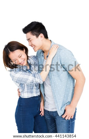Happy young couple embracing each other on white background - stock photo
