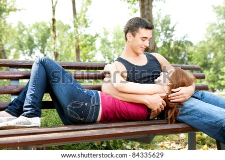 Happy young couple embracing each other outdoor