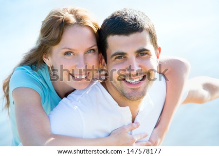 Happy young couple enjoying a solitary beach