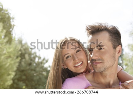 Happy young couple enjoying quality time in park