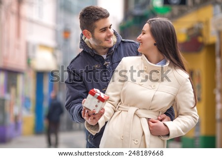 Happy young couple exchanging gifts on Valentine's Day. - stock photo