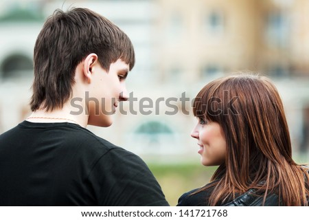 Happy young couple flirting - stock photo