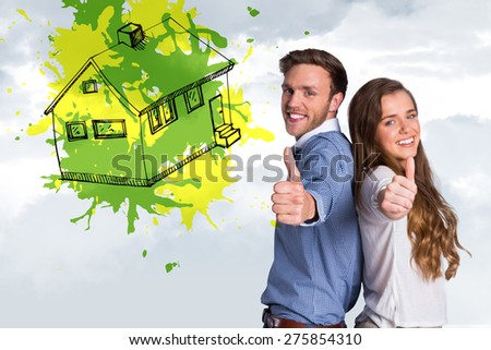 Happy young couple gesturing thumbs up against grey cloudy sky - stock photo