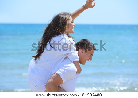 happy young couple have fun and relax  on the beach - stock photo