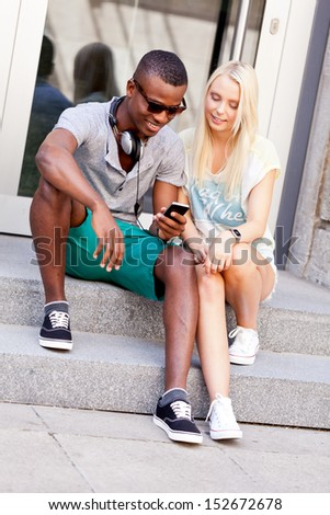 happy young couple have fun in the city summertime outdoor smiling lifestyle - stock photo