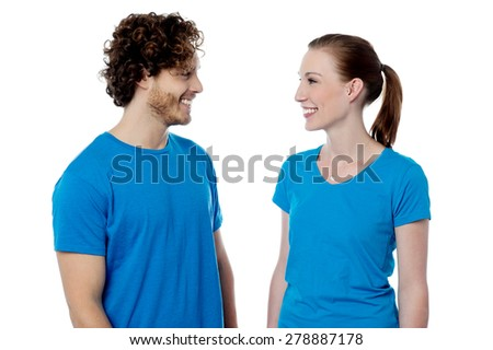 Happy young couple having a conversation - stock photo