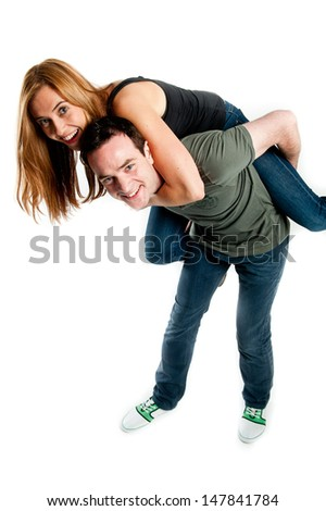 Happy young couple having a fun together - stock photo