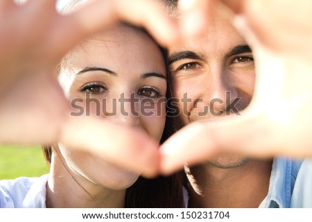 Happy young couple having fun in a park - stock photo