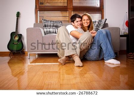Happy young couple having fun on the sofa - stock photo