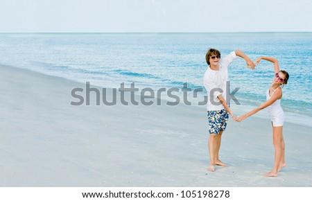 happy young couple having fun on tropical beach - stock photo