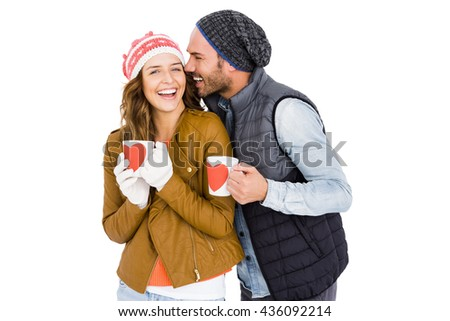Happy young couple holding coffee mug on white background