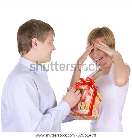 Happy young couple, husband does a gift to the wife. Isolated over white.
