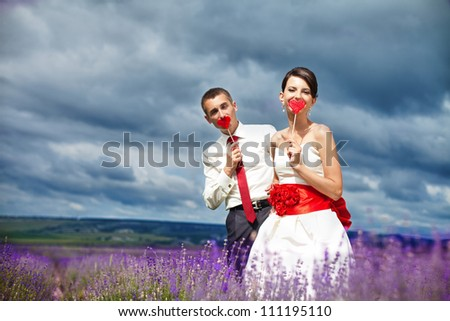 Happy young couple in a lavender field. Wedding day. A series of photos in my portfolio. - stock photo