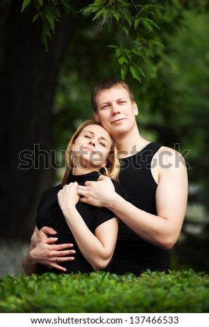 Happy young couple in a spring garden