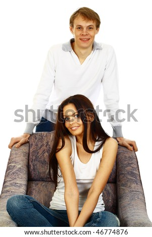 Happy young couple in casual clothing - stock photo