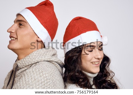 happy young couple in Christmas hats, love story, holiday, party,  Christmas