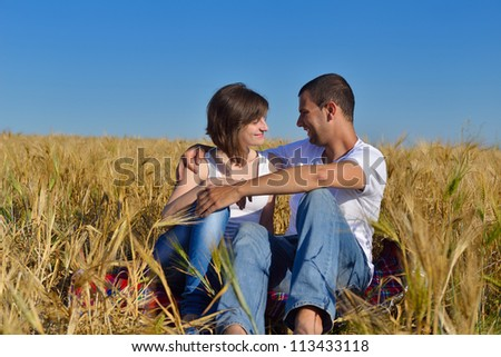 happy young couple in love have romance and fun at wheat field in summer - stock photo